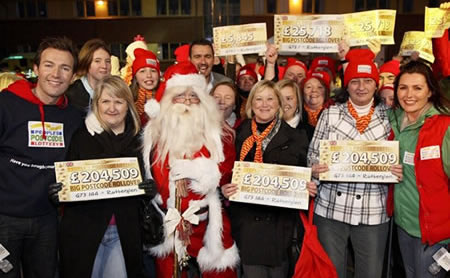 Santa with some of the lucky winners and presenters Angus Purden and Judie McCourt