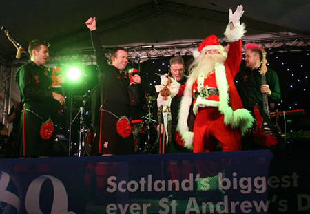 Santa with the Red Hot Chilli Pipers